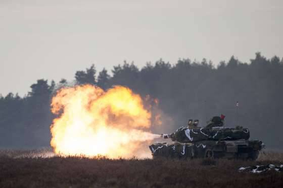 <figcaption>A US Abrams tank totally defensively and deterringly blasts away in Poland</figcaption>