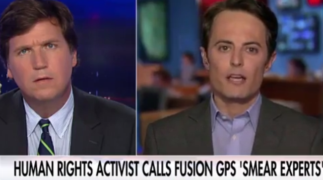 <figcaption>Halvorssen appearing on Carlson's show in late July</figcaption>
