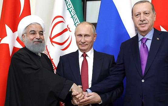 <figcaption>Iranian President Hassan Rouhani (L), Russian President Vladimir Putin (C) and Turkish President Recep Tayyip Erdogan (R) shake hands prior to the Syria talks in Sochi. ( Credit: CreartiveCommons/www.kremlin.ru.</figcaption>