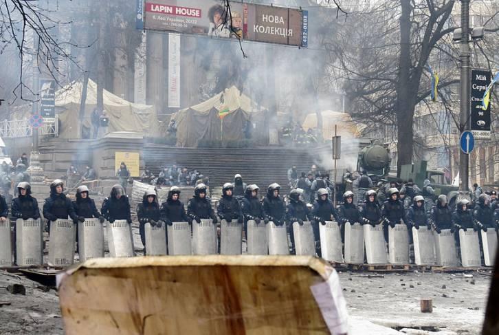 <figcaption>Police in Hrushevsky Street, Kiev, Feb. 12, 2014. (Wikimedia)</figcaption>