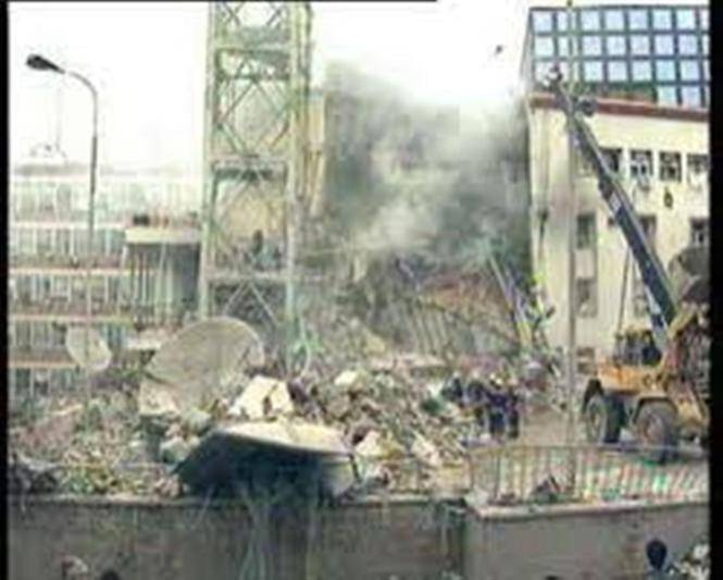 <figcaption>The morning after… NATO bombing of the Radio Television of Serbia headquarters resulted in the killing of 16 employees, wounding 19</figcaption>