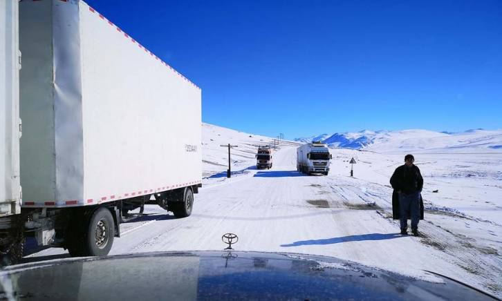 <figcaption>Chinese container cargo trucks after crossing the Kulma pass at the Tajik-China border. Photo: Pepe Escobar / Asia Times</figcaption>