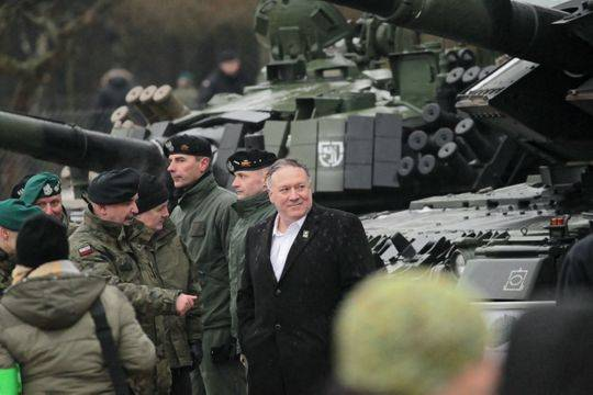 <figcaption>Secretary of State Mike Pompeo in Poland with NATO troops.</figcaption>