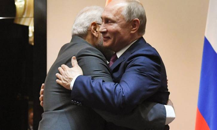 <figcaption>Russian President Vladimir Putin and Indian Prime Minister Narendra Modi (left) hug during their meeting before a session of the Heads of State Council of the Shanghai Cooperation Organization (SCO), in Bishkek, Kyrgyzstan. </figcaption>