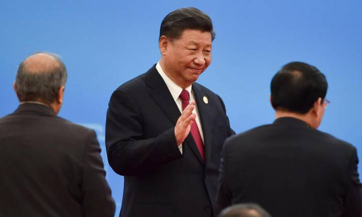 <figcaption>China's President Xi Jinping waves during the opening ceremony of the China International Import Expo in Shanghai on November 5.</figcaption>