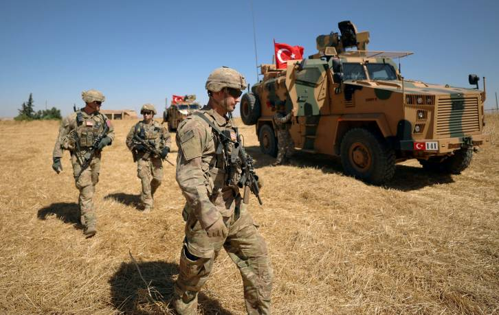 <figcaption>American soldiers walk together during a joint U.S.-Turkey patrol, near Tel Abyad, Syria September 8, 2019</figcaption>