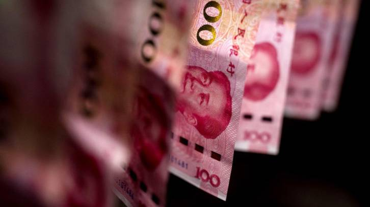 <figcaption>FILE PHOTO: Chinese one-hundred yuan banknotes © Getty Images / Paul Yeung</figcaption>