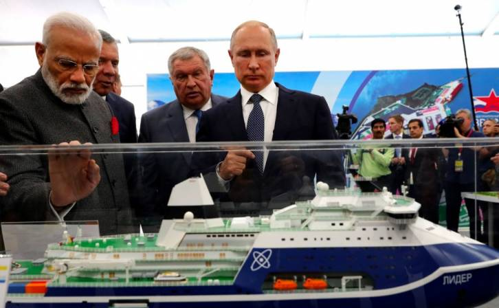 "<figcaption>Narenda Modi takes a look at the projected ""Lider"" icebreaker during a visit to the Zvezda Yard in Vladivostok along with Vladimir Putin and Igor Sechin. Photo: Kremlin.ru</figcaption>"