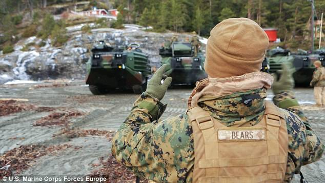 <figcaption>U.S. Marine Corps assault vehicles line up by the Trondheim Fjord, Norway  </figcaption>