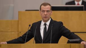 <figcaption>Prime Minister Dmitry Medvedev at the Duma today</figcaption>