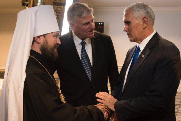 <figcaption>Mike Pence, Franklin Graham, and the 'Foreign Minister' of the Russian Church, Hilarion</figcaption>
