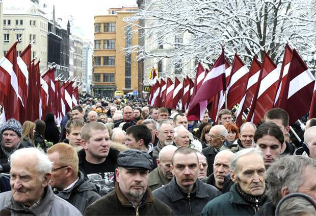 <figcaption>Fascist sympathies.  Latvians paying homage to soldiers who fought for the Nazis</figcaption>