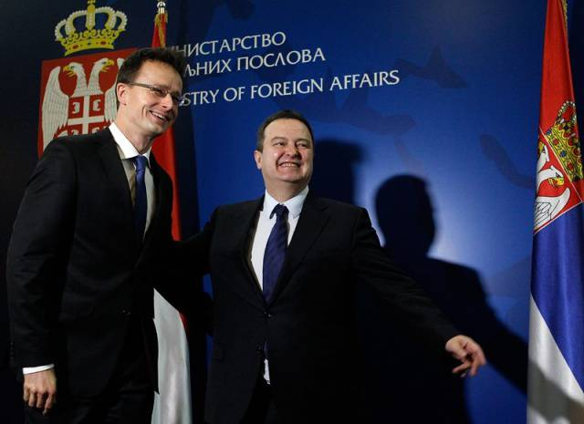 <figcaption>Hungarian Minister of Foreign Affairs and Trade Peter Szijjarto (L), and Serbian Minister of Foreign Affairs Ivica Dacic (R), during their meeting in Belgrade, Serbia, 14 January 2015.</figcaption>