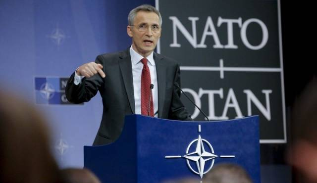<figcaption>Jens Stoltenberg, head of NATO, one of the silliest people to ever mount a public stage.  He is a Neocon-worshipper from gender-bending Norway, which explains a lot.</figcaption>