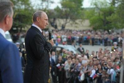 <figcaption>Russian President Vladimir Putin addresses a crowd on May 9, 2014, celebrating the 69th anniversary of victory over Nazi Germany and the 70th anniversary of the liberation of the Crimean port city of Sevastopol from the Nazis</figcaption>