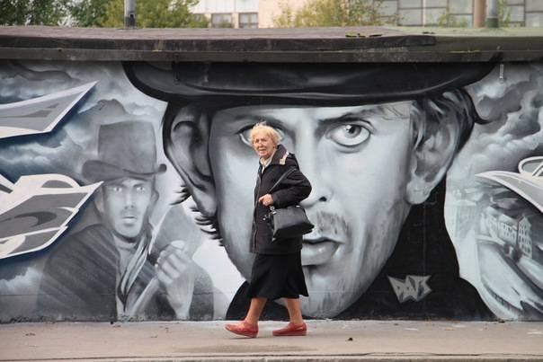 <figcaption>Street Art: Rodion Raskolnikov in Saint Petersburg, Russia</figcaption>
