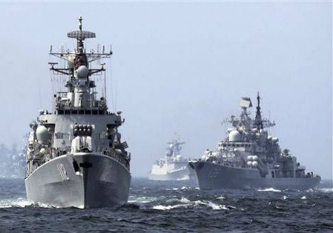 <figcaption>Chinese and Russian destroyers during an exercise</figcaption>