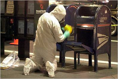 <figcaption>Disinfecting a mailbox -- a copy of The New York Times was found in it...</figcaption>