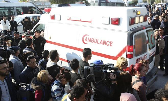 <figcaption>People surround an ambulance carrying the bodies of the victims of an attack by gunmen on Tunisia's national museum in Tunis, March 18, 2015.</figcaption>