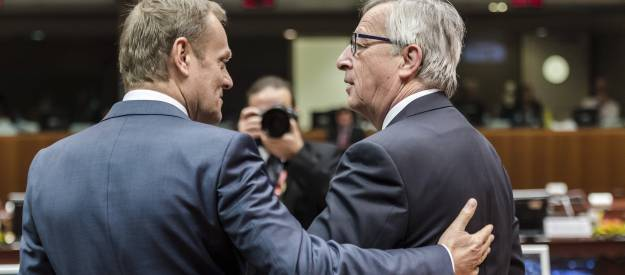 <figcaption>European Council President Donald Tusk, left, speaks with European Commission President Jean-Claude Juncker during a round table meeting at an EU summit in Brussels on Friday, March 20, 2015 | Photo: AP</figcaption>