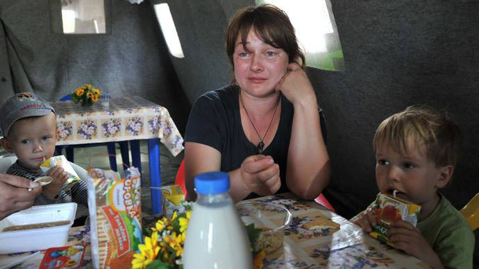 <figcaption>A woman with children from South-East of Ukraine at a refugee camp in  Rostov region | Photo: Sergey Pivovarov, RIA Novosti</figcaption>