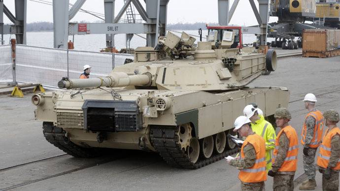 <figcaption>An Abrams main battle tank, for US troops deployed in the Baltics as part of NATO's Operation Atlantic Resolve, leaves Riga port March 9, 2015 | Ints Kalnins, Reuters</figcaption>