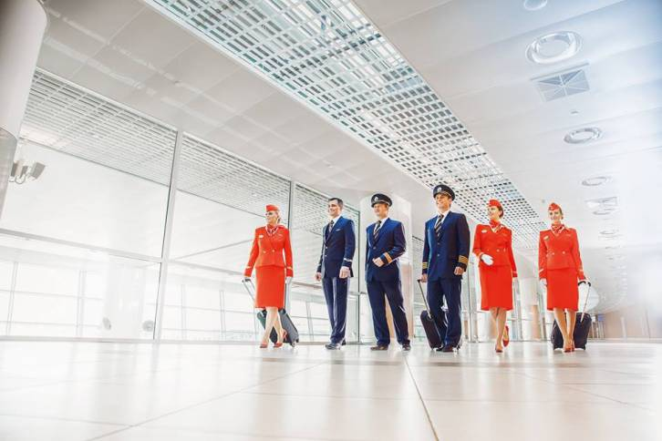 <figcaption>Aeroflot flight-attendants wear the most elegant uniform according to the global search system Yahoo.com</figcaption>