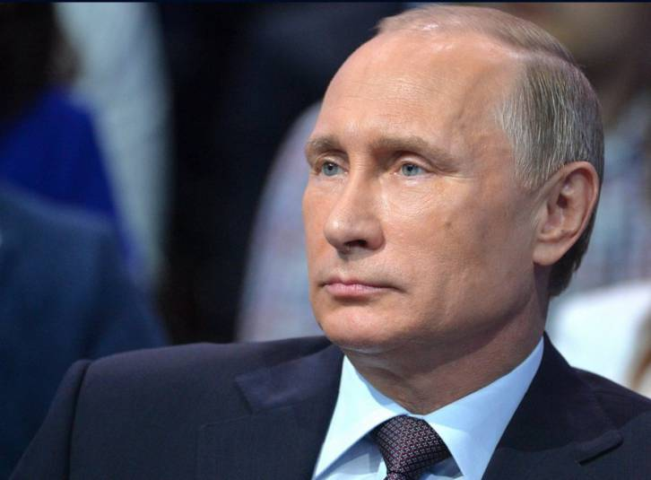 <figcaption>Vladimir Putin at the Truth and Justice Second Media Forum of Independent Local and Regional Media</figcaption>