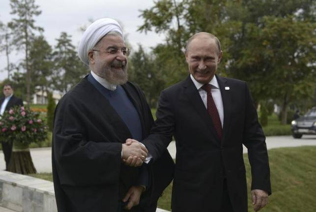 <figcaption>Russia's President Vladimir Putin (R) shakes hands with his Iranian counterpart Hassan Rouhani at the welcoming ceremony during a summit of Caspian Sea regional leaders in the southern city of Astrakhan, September 29, 2014.</figcaption>
