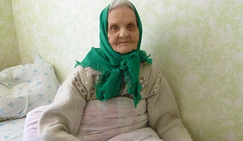 <figcaption>Veteran of the Belorussian Front, safe, comfortable, remembered.</figcaption>