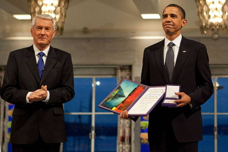 <figcaption>President Barack Obama uncomfortably accepting the Nobel Peace Prize from Committee Chairman Thorbjorn Jagland in Oslo, Norway, Dec. 10, 2009.</figcaption>